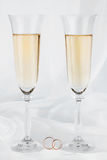 Wedding rings and wedding glasses Royalty Free Stock Image