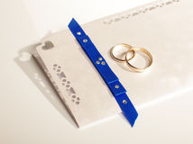 Wedding rings and wedding invitation Stock Photo