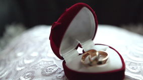 Wedding rings. wedding ring box. Two wedding rings in a velvet box stock footage