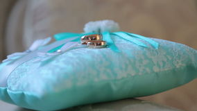 Wedding rings. Wedding rings lying on the pillow. stock video footage