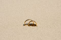 Wedding Rings. On Sand Beach Royalty Free Stock Photography