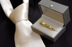 Wedding rings & wedding tie royalty free stock photo