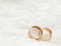 Wedding rings on white. Wedding accessories arrangement white gloves and gold rings Royalty Free Stock Photo
