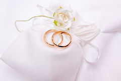 Wedding rings on a white cloth bag. With flower Royalty Free Stock Images