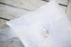 Wedding rings on a white cushion Royalty Free Stock Image