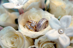 Wedding rings in white flowers Royalty Free Stock Photo