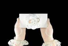 Wedding rings on a white gift box Stock Photo