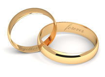 Wedding rings on white. Gold wedding rings engraved with the text forever together Royalty Free Stock Photography