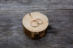 Wedding rings white gold on wooden background Stock Photos