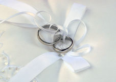 Wedding rings on white lace pad Royalty Free Stock Photography