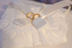 Wedding Rings on White Pillow Stock Image