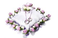 Wedding rings on white pillow isolated on white background Stock Photos