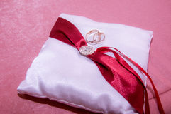 Wedding rings on the white  pillow Stock Photography