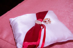 Wedding rings on the white pillow royalty free stock photography