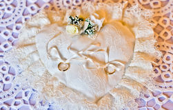 Wedding rings on a white pillow white Royalty Free Stock Images