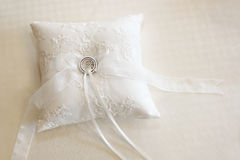 Wedding rings on a white ring pillow Royalty Free Stock Image