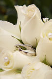 Wedding Rings and White Roses Royalty Free Stock Image