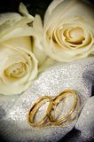 Wedding rings with white roses. stock images