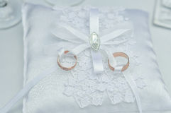 Wedding rings on a white satin pillow Stock Photo