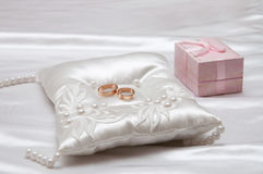 Wedding rings on a white satin pillow Royalty Free Stock Photo