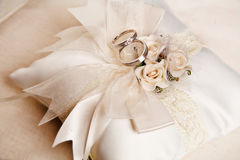 Wedding rings on a white satiny fabric Stock Photography