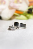 Wedding rings on white table Stock Photo