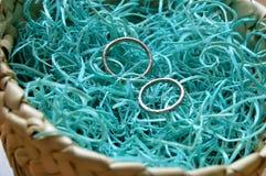 Wedding rings in wicker basket stock images