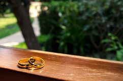 Wedding rings on window in a sunbeam Royalty Free Stock Photo