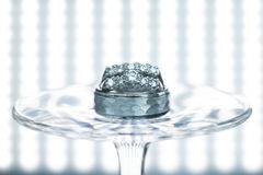 Wedding rings on a wine glass. At reception Royalty Free Stock Image