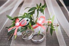 Wedding rings. On wood desk Stock Photos