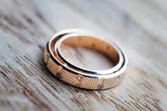 Wedding rings on wood panel Royalty Free Stock Photo