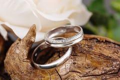 Wedding rings on wood Royalty Free Stock Image