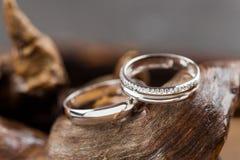 Wedding rings on wood Stock Image