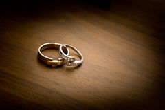 Wedding rings on a wooden background. With vignette effect Royalty Free Stock Images