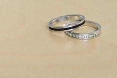 Wedding rings on wooden background. Royalty Free Stock Image