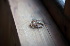 Wedding rings on a wooden background Stock Photography
