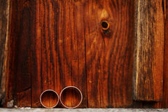 Wedding rings on wooden background. Love concept of marriage. Stock Image