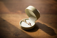 Wedding rings on wooden background Stock Images