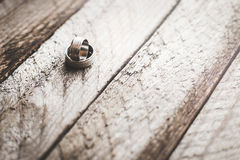 Wedding rings on a wooden background Stock Photo