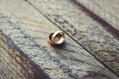 Wedding rings on a wooden background Royalty Free Stock Photo