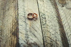 Wedding rings on a wooden background Royalty Free Stock Photos