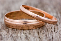 Wedding rings on a wooden background Royalty Free Stock Images
