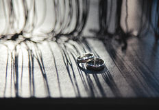 Wedding rings on a wooden board Stock Photography