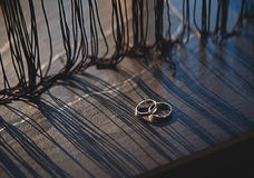 Wedding rings on a wooden board Royalty Free Stock Photography