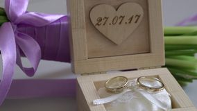 Wedding rings in wooden box stock video footage