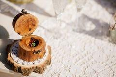 Wedding rings in wooden box macro Stock Images