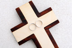 Wedding Rings and wooden cross Stock Photos