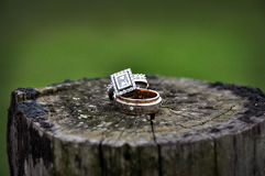 Wedding rings on wooden fence pole Royalty Free Stock Images