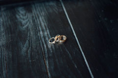 Wedding rings on a wooden floor Royalty Free Stock Images