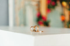 Wedding rings on a wooden floor Stock Image